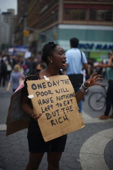 """One Day the Poor Will Have Nothing Left to Eat But the Rich"", Occupy Wall Street, New York, October 2011."