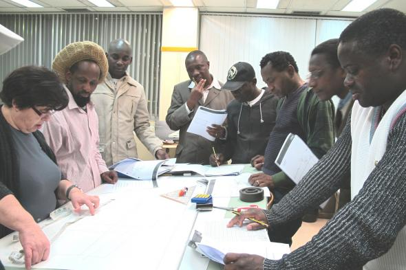 Fig. 3 – The teacher and the group of tailors working on an exercise.