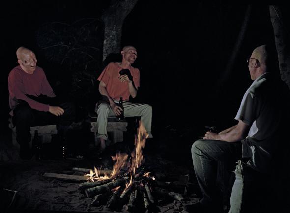 João Maria Gusmão + Pedro Paiva. Three albinos telling jokes at the fire, 2013. Chromogenic colour print, 60 x 90 cm