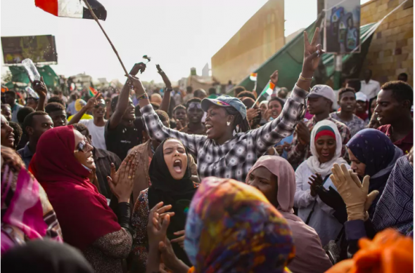 Sudanese demonstrators celebrate the arrest of long-time President Omar al-Bashir by the armed forces, outside the Defense Ministry. Ala Kheir/Picture Alliance via Getty Images