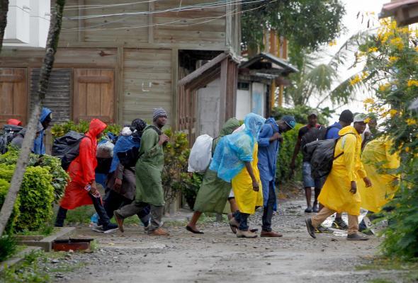 El Tiempo (Javier Nieto) - Trânsito de migrantes africanos no norte da Colômbia em direção à selva do Darién, no Panamá