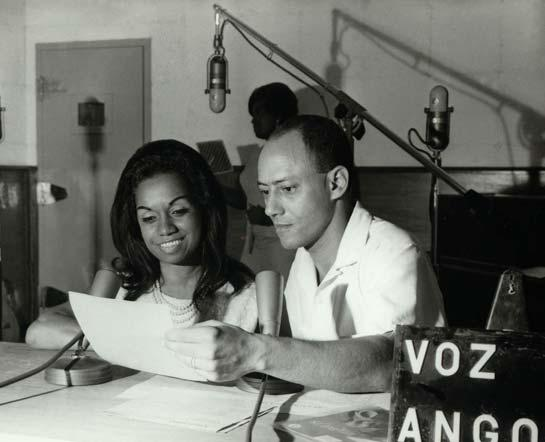 At the radio microphones in Angola, with the presenter José Guize