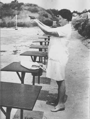 (House wife learning how to shoot in Johannesburg)