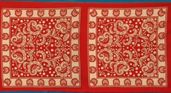 kanga do Zanzibar com motivos semelhantes à dos lenços portugueses