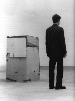 Santiago Sierra, Trabajadores que no pueden ser pagados rumenerados para permanecer en el interior de cajas carton (Workers who cannot be paid, remunerated to remain inside cardboard boxes), 2000. Courtesy of Lisson Gallery, London.